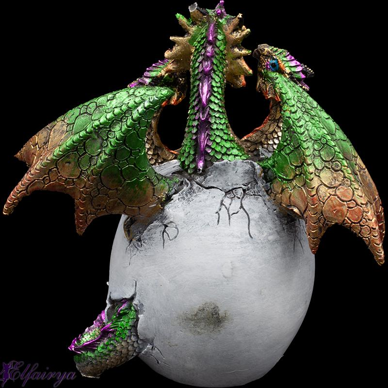 Little young dragons hatch from a dragon egg